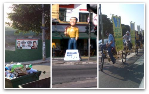 Cartazes, bonecos e bicicleta com propaganda eleitoral